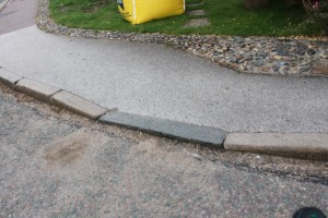 "An example of a ""dropped-kerb"" that made my wheelchair slam against it."