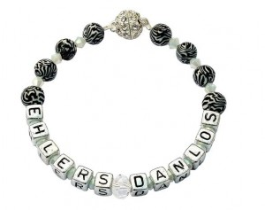 An Ehlers-Danlos Syndrome bracelet featuring zebra stripe beads - the symbol of the condition