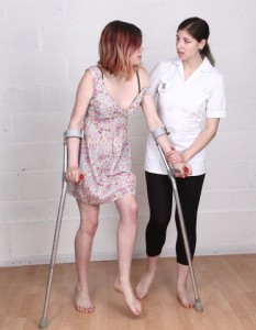 http://www.dreamstime.com/stock-image-female-physiotherapist-nurse-helping-young-women-crutches-image31883631